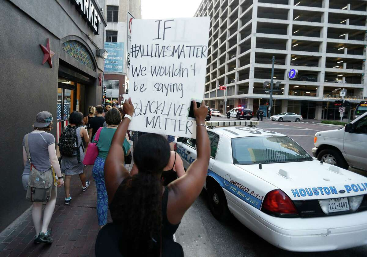 Protesters march up the street chanting during a Black Lives Matter rally that began at Discovery Green and ended at City Hall, Friday, July 8, 2016, in Houston.