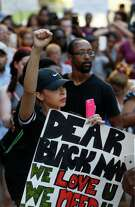 Black Lives Matter protesters participate Friday in a march from Discovery Green to the steps of City Hall, a day after a Dallas-area sniper killed five police officers during a nonviolent protest.