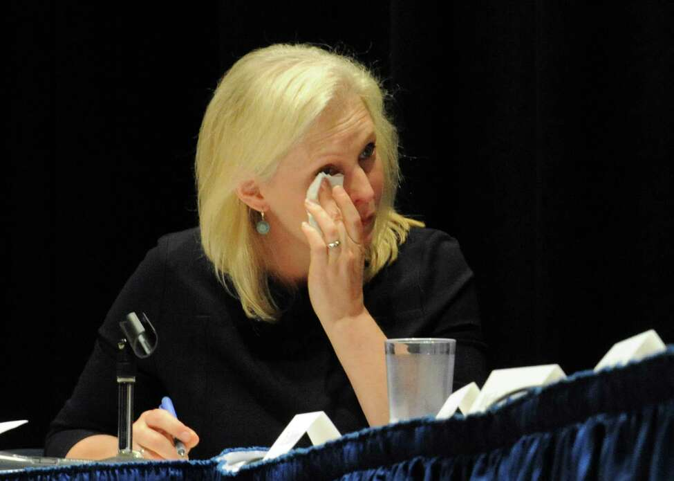 U.S. Senator Kirsten Gillibrand wipes tears from her eyes as she listens to Hoosick resident Emily Mapes tell how the PFOA contamination has personally impacted her life during a roundtable discussion at Hoosick Falls Central School on Friday July 8, 2016 in Hoosick falls, N.Y. (Michael P. Farrell/Times Union)