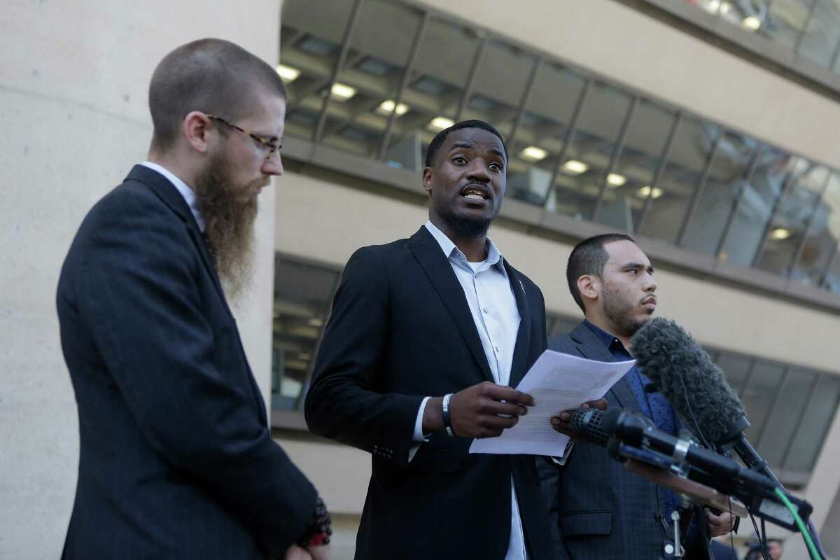 Dominique Alexander (center) has protested against First Baptist Dallas and its pastor Robert Jeffress for his support of president-elect Donald Trump. Jeffress called Alexander a