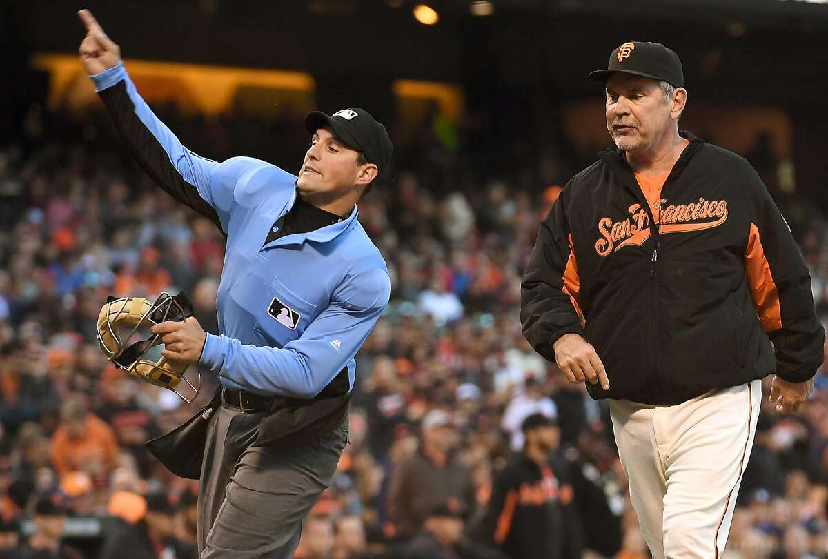 SAN FRANCISCO, CA - JULY 08: Home plate umpire Quinn Wolcott #81 throws manager Bruce Bochy #15 of the San Francisco Giants out of the game against the Arizona Diamondbacks in the bottom of the second inning at AT&T Park on July 8, 2016 in San Francisco, California. (Photo by Thearon W. Henderson/Getty Images)