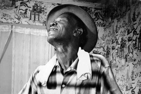 08/23/1959 - Blues guitarist Sam 'Lightnin' Hopkins.