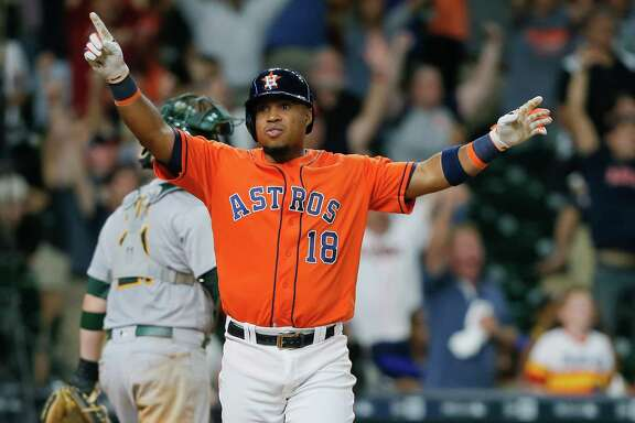 HOUSTON, TX - JULY 08:  Luis Valbuena #18 of the Houston Astros hits a three run walkoff home run in the ninth inning to defeat the Oakland Athletics at Minute Maid Park on July 8, 2016 in Houston, Texas.