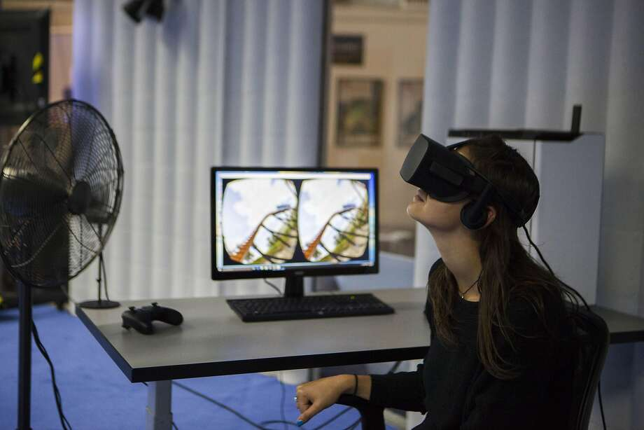 Emanuela Boisbouvier, a UCLA student, experiences a virtual-reality roller coaster at the Urban Safari arcade in the Innovation Hangar in San Francisco. Photo: Michael Noble Jr., The Chronicle