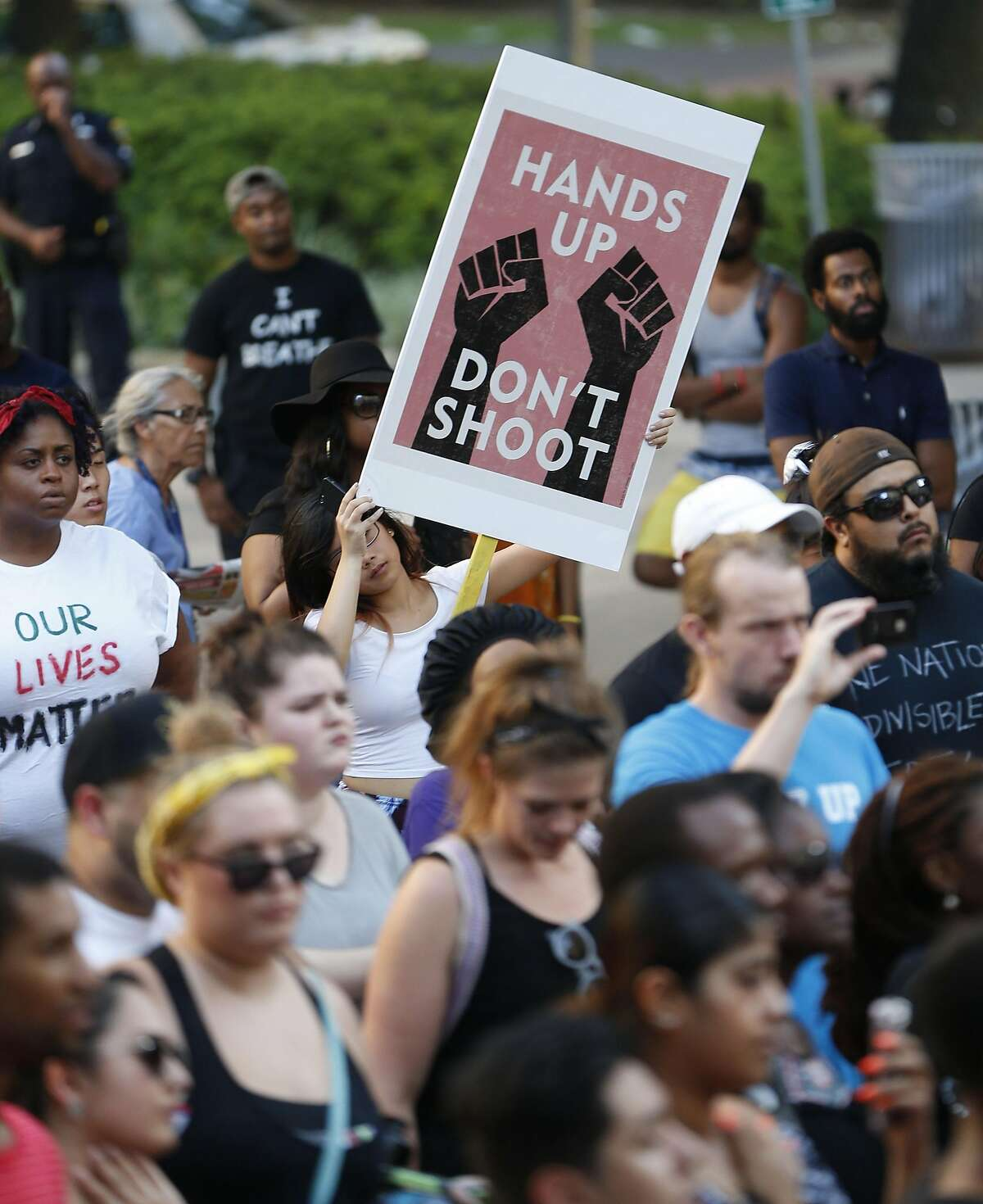 A protester holds a sign during a Black Lives Matter rally that began at Discovery Green and ended at City Hall, Friday, July 8, 2016, in Houston. ( Karen Warren / Houston Chronicle )