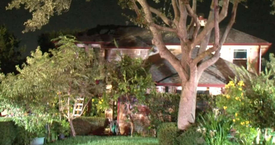 An overnight fire in Stafford damaged a home in the Southmeadow subdivision and overwhelmed at least two firefighters who were treated on the scene for heat exhaustion. Photo: Metro Video