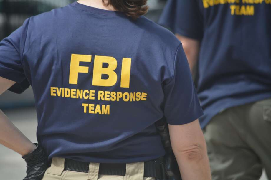 About 10 FBI officers moved along the Dallas' streets to uncover any evidence left behind Thursday night in downtown. July 9, 2016 Photo: John Harden