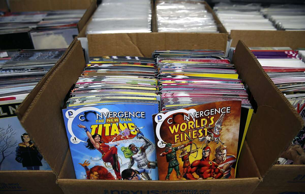 Boxes of comic books from all genres are lined up for a 25 cents sale by the Friends of the San Francisco Public Library in San Francisco, Calif. on Saturday, July 9, 2016.
