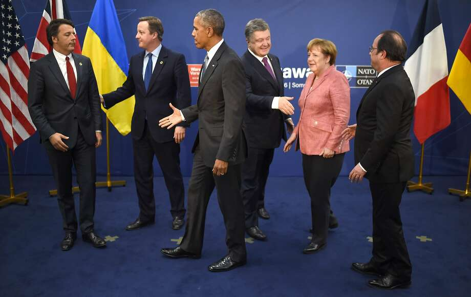 (L to R) Italy's Prime Minister Matteo Renzi, Britain's Prime Minister David Cameron, US President Barack Obama, Ukraine's President Petro Poroshenko, Germany's Chancellor Angela Merkel and France's President Francois Hollande talk after posing for a photo after a quint meeting during the NATO Summit at the Polish National Stadium in Warsaw on July 9, 2016. The Polish capital hosts a two-day NATO summit, the first time ever that it hosts a top-level meeting of the Western military alliance which it joined in 1999. / AFP PHOTO / STEPHANE DE SAKUTINSTEPHANE DE SAKUTIN/AFP/Getty Images Photo: STEPHANE DE SAKUTIN, AFP/Getty Images