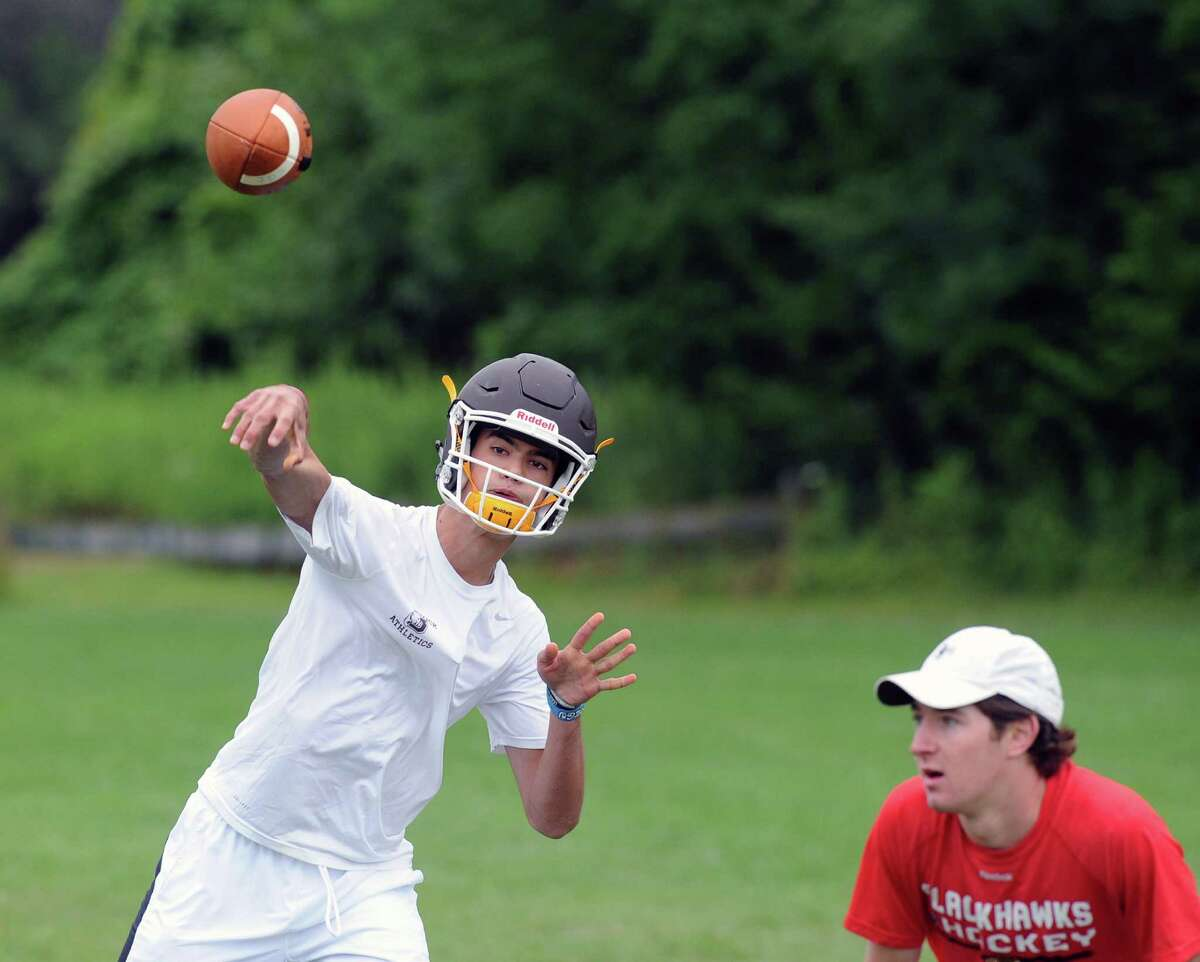 Brunswick School quarterback Nick Henkel throws during the annual Grip It & Rip It 7-on-7 football tournament at New Canaan High School, Conn., Saturday, July 9, 2016.