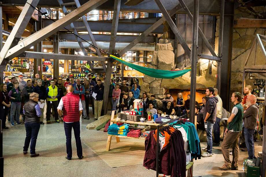 REI announced Sunday that it will boost pay for workers in seven U.S. cities, including Seattle, starting in August. Photo: Suzi Pratt/Getty Images For REI