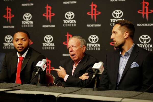 Eric Gordon, Leslie Alexander, and Ryan Anderson sit at a table as they speak to the media at the Houston Rockets, Saturday, July 9, 2016, in Houston.