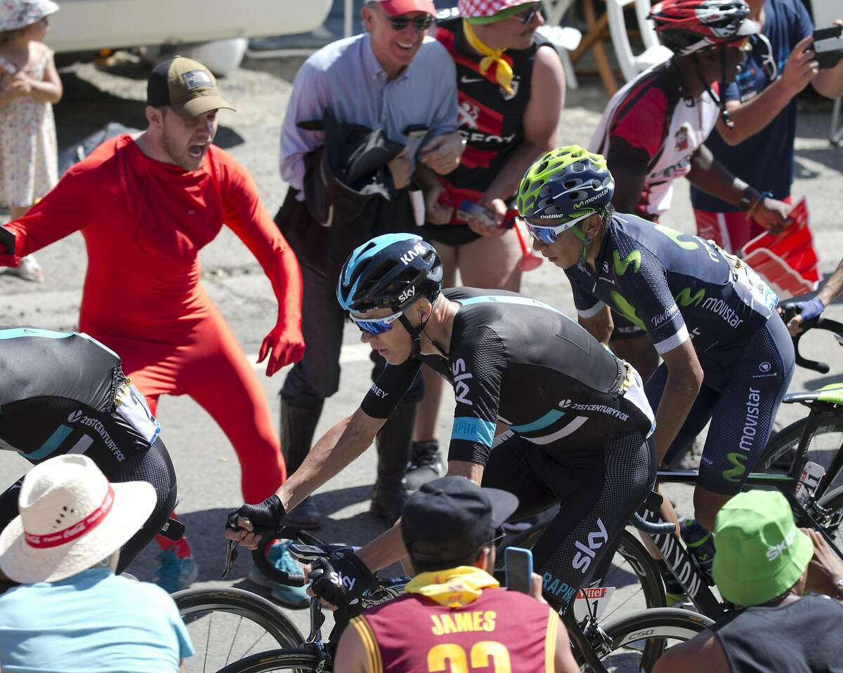 New overall leader Britain's Chris Froome, center, and Colombia�s Nairo Quintana climb Peyresourde pass during the eighth stage of the Tour de France cycling race over 184 kilometers (114.3 miles) with start in Pau and finish in Bagneres-de-Luchon, France, Saturday, July 9, 2016. (AP Photo/Peter Dejong)