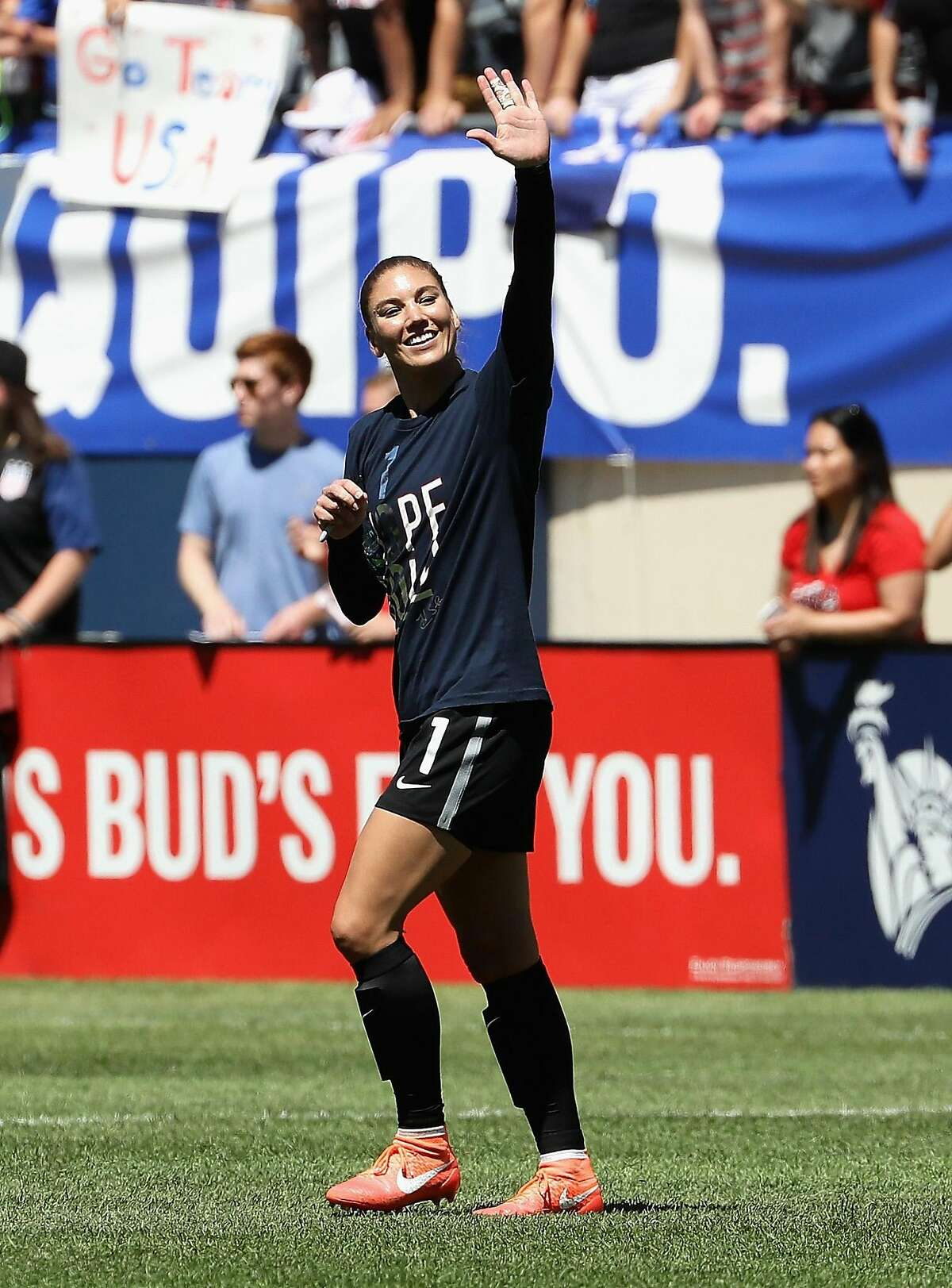 CHICAGO, IL - JULY 09: Hope Solo #1 of the United States waves to the crowd after posting her100th career shut-out against South Africa after a friendly match at Soldier Field on July 9, 2016 in Chicago, Illinois. The United States defeated South Africa 1-0. (Photo by Jonathan Daniel/Getty Images)