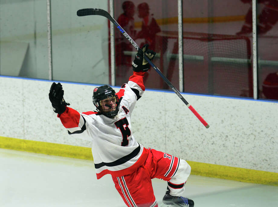 Fairfield Warde/Ludlowe's Jake Fuss celebrates a goal during boys hockey action against Ridgefield at the Wonderland of Ice in Bridgeport, Conn., on Wednesday Jan. 13, 2016. Photo: Christian Abraham / Hearst Connecticut Media / Connecticut Post