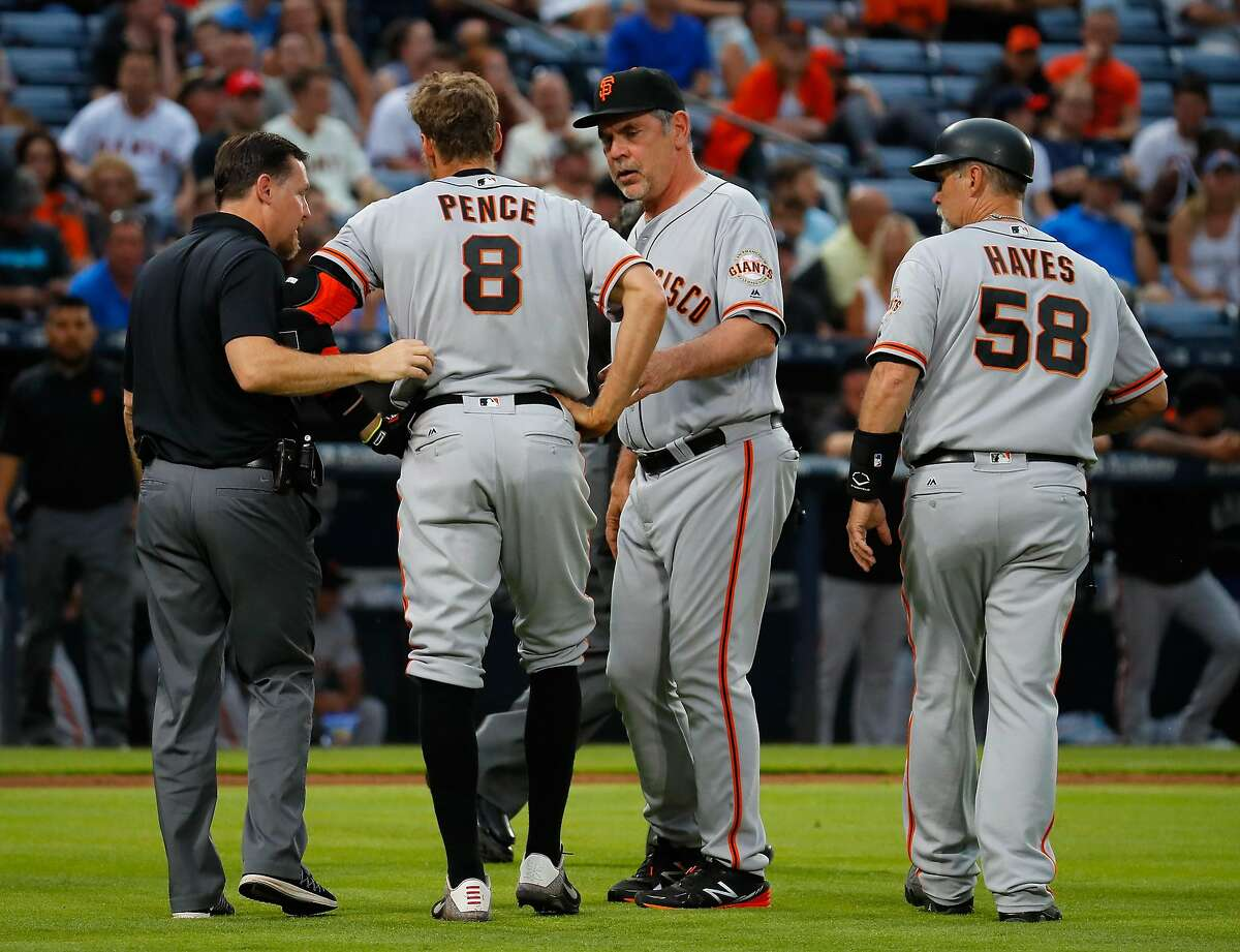 ATLANTA, GA - JUNE 01: Hunter Pence #8 of the San Francisco Giants is helped off the field by manager Bruce Bochy #15 after injuring his leg pulling up short running to first base on a ground out in the fourth inning against the Atlanta Braves at Turner Field on June 1, 2016 in Atlanta, Georgia. (Photo by Kevin C. Cox/Getty Images)