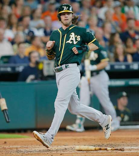 With contract extension talks going nowhere, outfielder Josh Reddick appears to be a trade candidate for the A's. Photo: Bob Levey, Getty Images