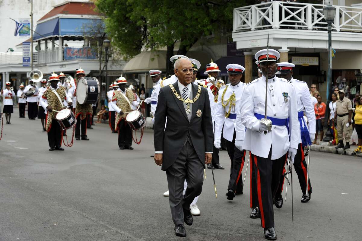 Governor General Sir Arthur Foulkes on a street parade in Nassau,Bahamas. The island nation on Friday issued a travel warning to its citizens regarding American police after a spate of nationwide protests over killings of black men by law enforcement. Keep clicking to see famous viral videos of abuse by U.S. police...