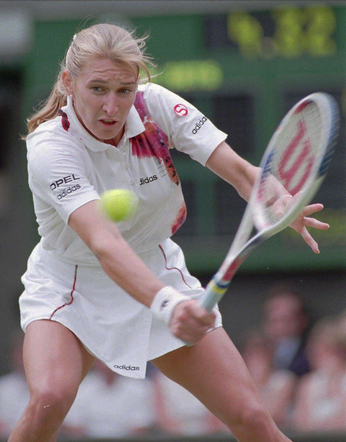 Steffi Graf returns to Mary Joe Fernandez, of the U.S. during their women's singles quarterfinal on Wimbledon's Center Court Tuesday July 4, 1995. Graf won the match 6-3, 6-0, and will play Jana Novotna in the semifinal. (AP Photo/Dave Caulkin)