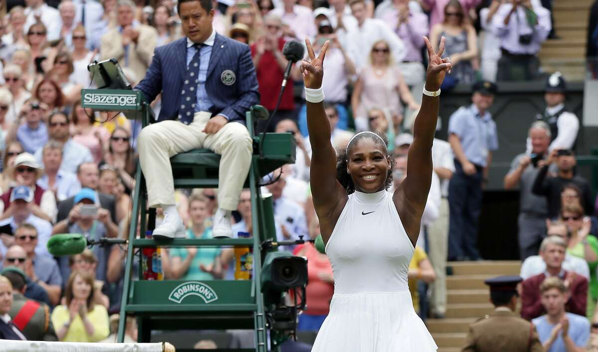 Serena Williams of the U.S celebrates after beating Angelique Kerber of Germany in the women's singles final on day thirteen of the Wimbledon Tennis Championships in London, Saturday, July 9, 2016. (AP Photo/Tim Ireland)