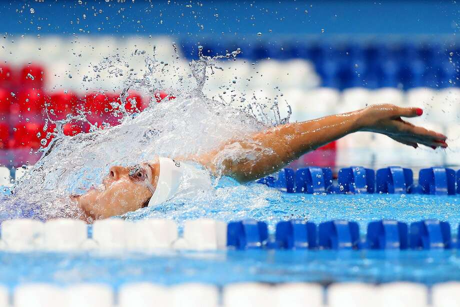 Santa Rosa native Maya DiRado churns through the water in the 200-meter backstroke at the U.S. Olympic trials. She won that race, and two others, while qualifying for the Rio Games. Photo: Tom Pennington, Getty Images