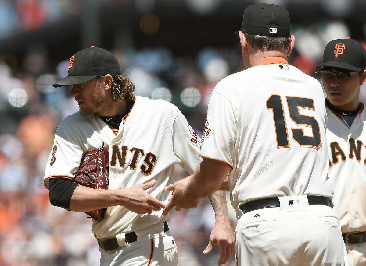 Manager Bruce Bochy #15 of the San Francisco Giants takes the ball from starting pitcher Jake Peavy #22, removing him from the game against the Arizona Diamondbacks in the top of the fifth inning at AT&T Park on July 9, 2016 in San Francisco.