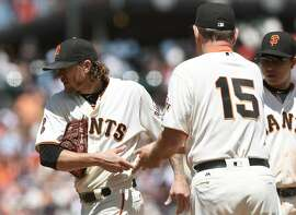 SAN FRANCISCO, CA - JULY 09:  Manager Bruce Bochy #15 of the San Francisco Giants take the ball from starting pitcher Jake Peavy #22 taking him out of the game against the Arizona Diamondbacks in the top of the fifth inning at AT&T Park on July 9, 2016 in San Francisco, California.  (Photo by Thearon W. Henderson/Getty Images)