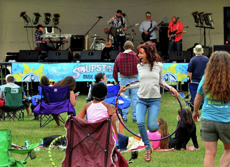 Chey Kistner, of Naugatuck, plays with a hoola-hoop during the 7th Annual Soupstock Music and Arts Festival in Shelton, Conn. on Saturday July 9, 2016. Soupstock features 2 stages of live music, a chili competition on Sunday, Kids Zone, over 50 handmade artisans, an Artisan Expo Pavilion, a variety of food trucks and more. The festival continues on Sunday from 11 a.m. to 8 p.m. Photo: Christian Abraham / Hearst Connecticut Media / Connecticut Post
