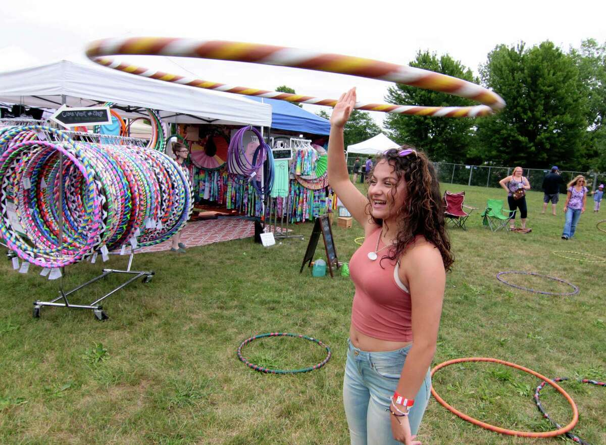 Christina Hernandez, of Shelton, enjoys the 7th Annual Soupstock Music and Arts Festival in Shelton, Conn. on Saturday July 9, 2016. Soupstock features 2 stages of live music, a chili competition on Sunday, Kids Zone, over 50 handmade artisans, an Artisan Expo Pavilion, a variety of food trucks and more. The festival continues on Sunday from 11 a.m. to 8 p.m.