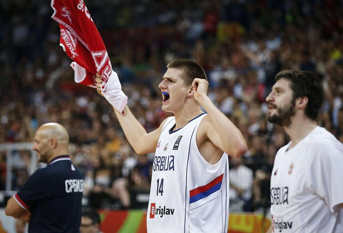 BELGRADE, SERBIA - JULY 09: Nikola Jokic (L) and Stefan Markovic (R) of Serbia celebrate during the 2016 FIBA World Olympic Qualifying basketball Final match between Serbia and Puerto Rico at Kombank Arena on July 09, 2016 in Belgrade, Serbia. (Photo by Srdjan Stevanovic/Getty Images)