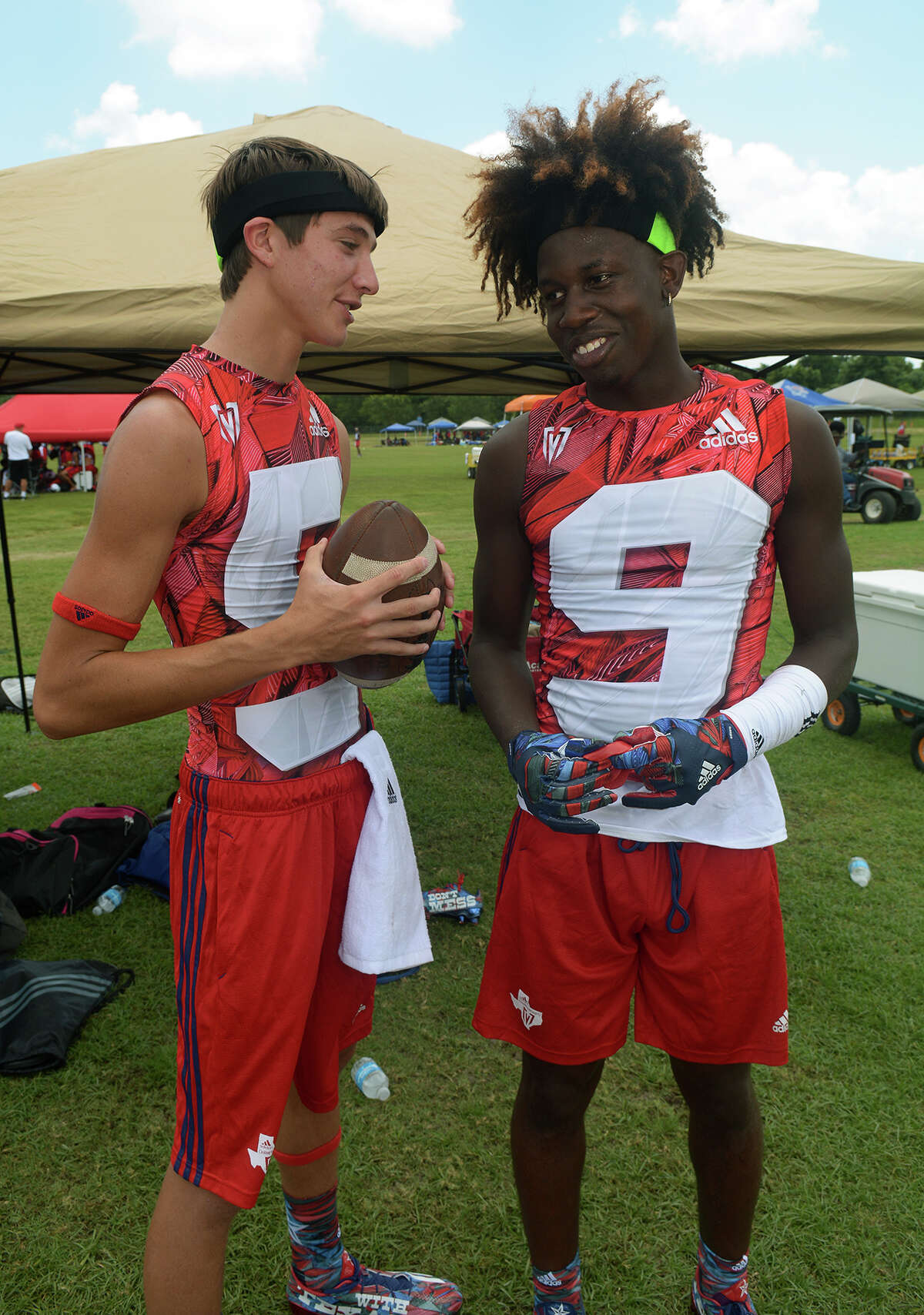 Dickinson senior quarterback Jordan Griggs, left, and sophomore wide receiver Malik Williams wait for the start of the 2nd half of their Division I pool game against Harker Heights at the 2016 Texas 7on7 Championships at Veterans Park and Athletic Complex in College Station on Friday, July 8, 2016. (Photo by Jerry Baker/Freelance)