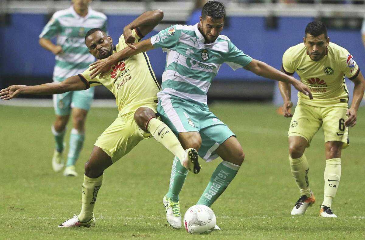 Club America's (7) (left) tries to steal the ball from (8) center as Club America teammate (6) looks on during a Mexican League exhibition soccer match between Club America and Club Santos Laguna at the Alamodome on July 9, 2016.