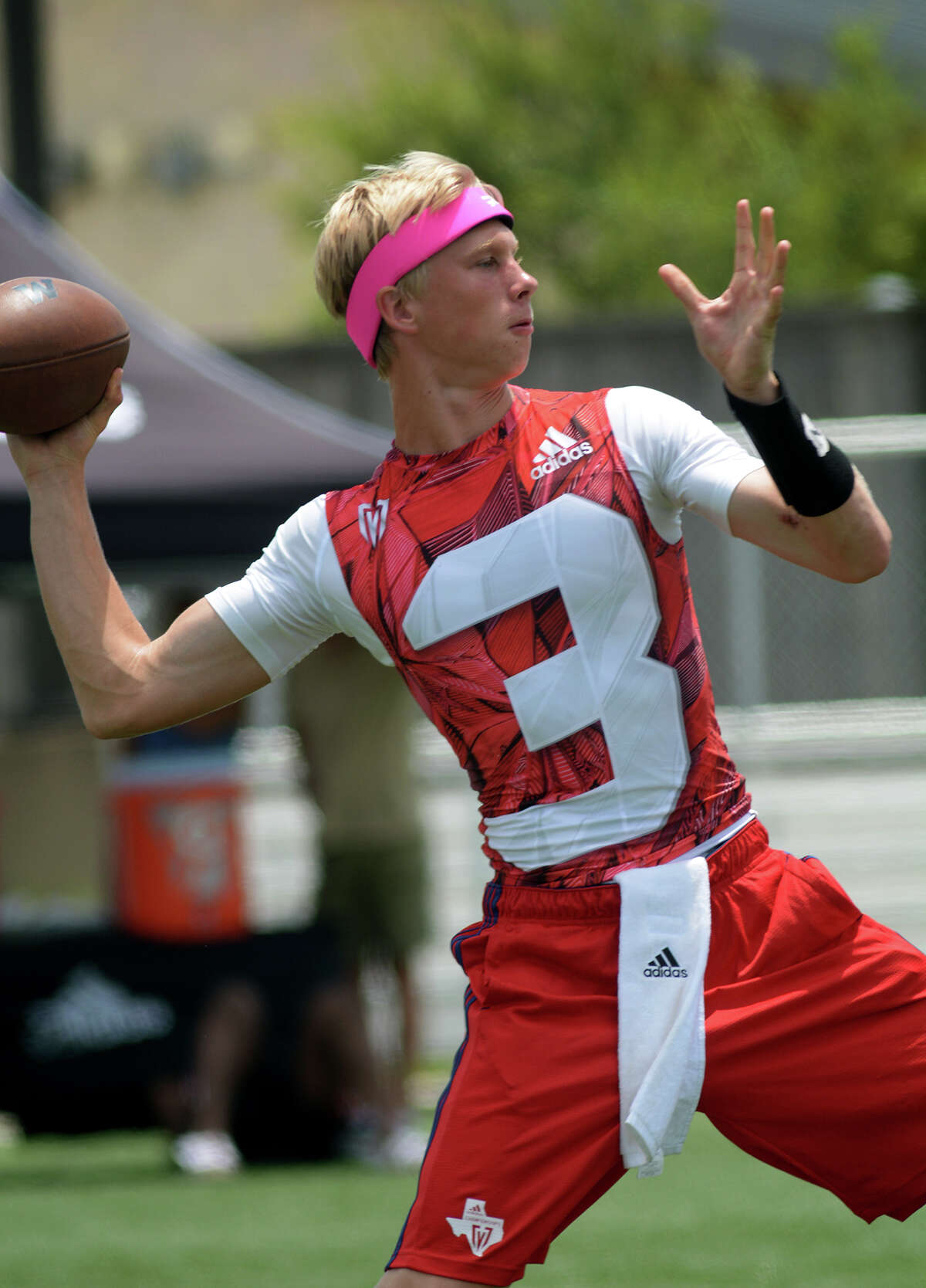The Woodlands quarterback Eric Schmid targets a receiver against College Station during their Division I quarterfinals matchup at the 2016 Texas 7on7 Championships at Veterans Park and Athletic Complex in College Station on Saturday, July 9, 2016. (Photo by Jerry Baker/Freelance)