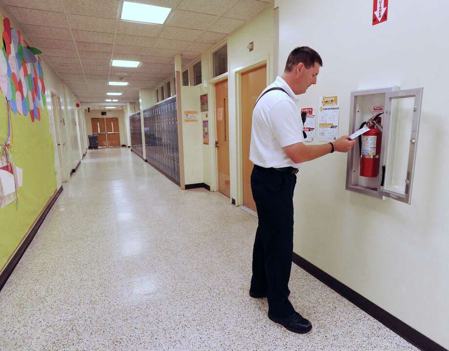 Town of Greenwich Deputy Fire Marshal Chris Moynahan during a fire safety inspection of Greenwich High School. Photo: Bob Luckey Jr. / Hearst Connecticut Media / Greenwich Time