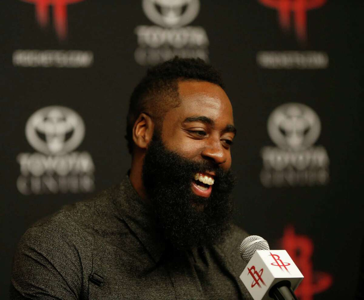 James Harden speaks during a news conference Saturday after he agreed to a four-year, $118 million renegotiation that could keep him under contract with the Rockets through 2020.