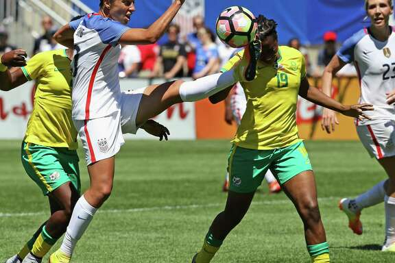 Carli Lloyd, left, who plays for the Dash, was back in action for the first time since suffering a knee injury in April, entering Saturday's match against South Africa in the second half as a substitute for the U.S. national team.