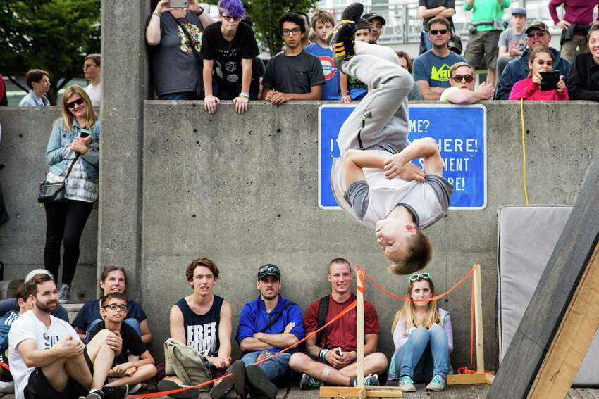 A competitor pulls an aerial off an angled wall during style portion of the Western Parkour Championships at Waterfront Park on Saturday, July 9, 2016.