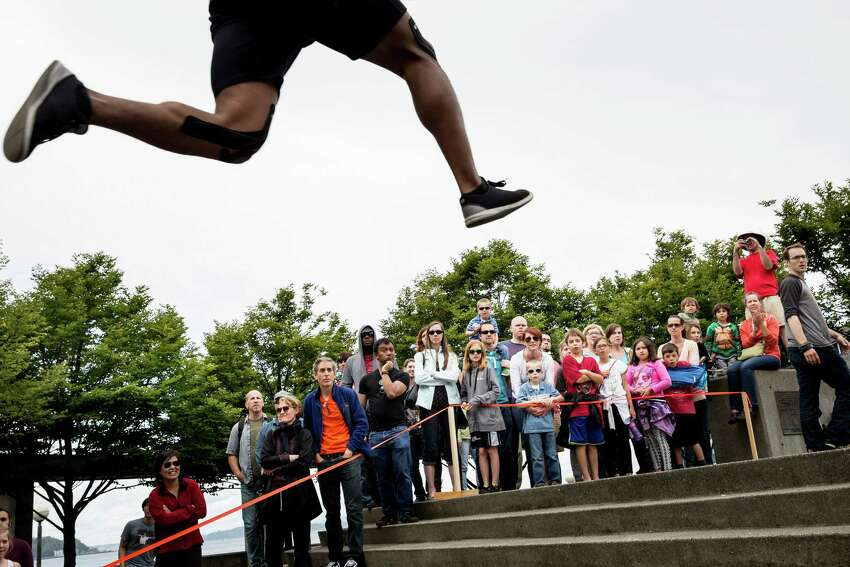 Darryl Stingley leaps during the speed portion of the Western Parkour Championships at Waterfront Park on Saturday, July 9, 2016.