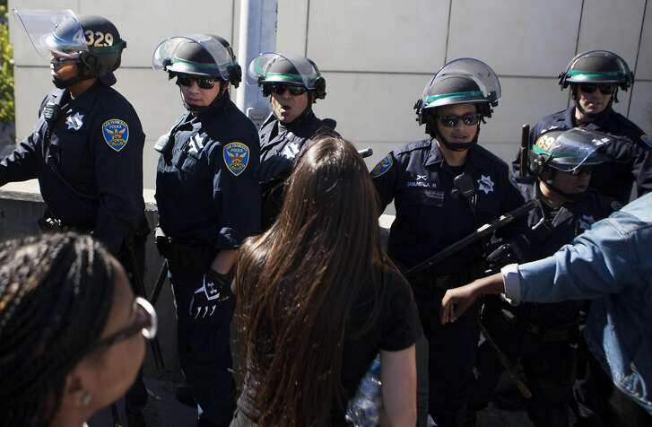 Police try to head off protesters on Friday, July 9, 2016 at off ramp in San Francisco, California. Protesters blocked the off ramp till they were ordered to leave.
