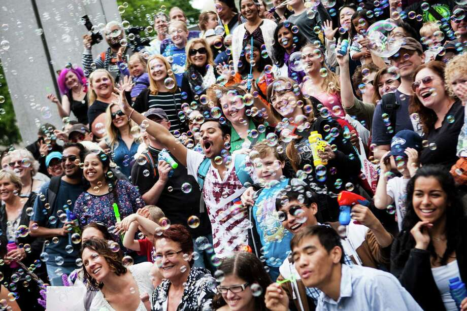 International Bubble Flash Mob participants pose for a group photo post flash mob at Westlake Park in downtown Seattle on July 9, 2016. Photo: LACEY YOUNG, SEATTLEPI.COM / seattlepi.com