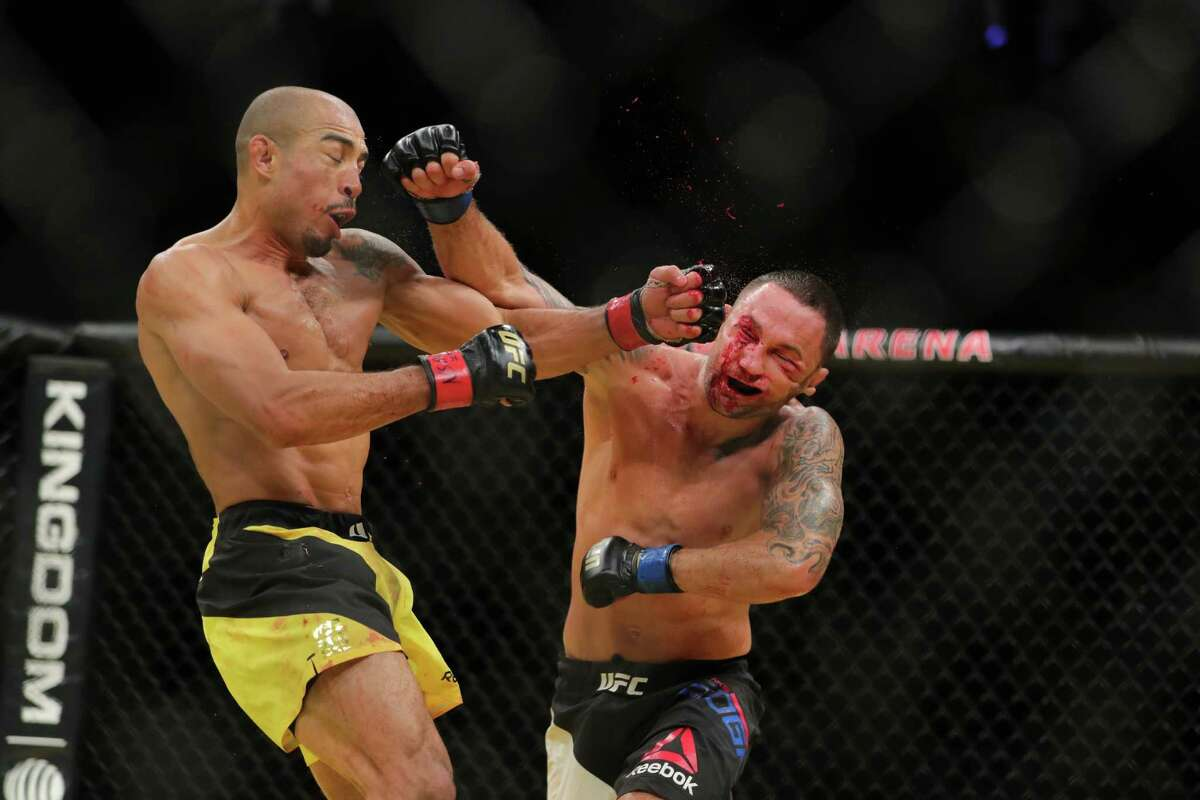 LAS VEGAS, NV - JULY 9: Jose Aldo punches Frankie Edgar during the UFC 200 event at T-Mobile Arena on July 9, 2016 in Las Vegas, Nevada.
