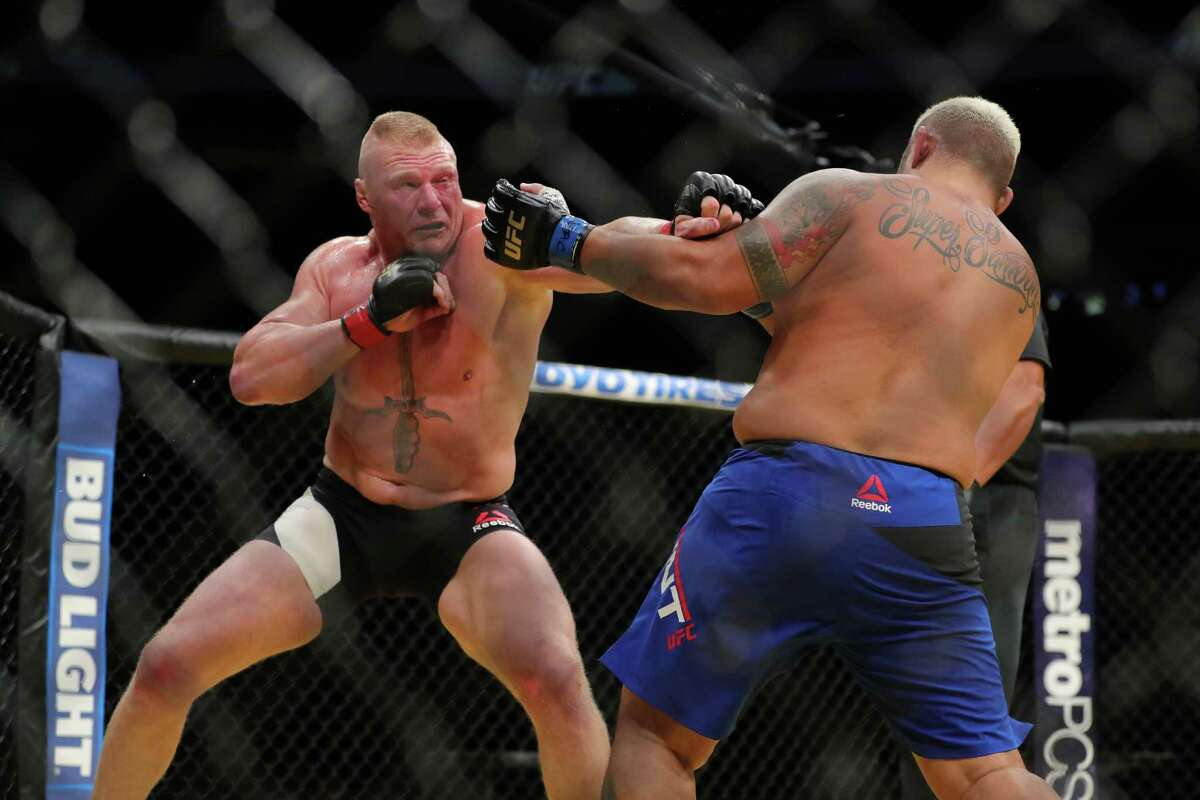 LAS VEGAS, NV - JULY 9: Brock Lesnar punches Mark Hunt (R) during the UFC 200 event at T-Mobile Arena on July 9, 2016 in Las Vegas, Nevada.