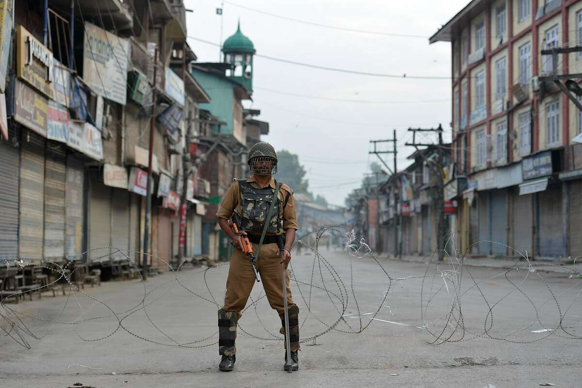 TOPSHOT - An Indian paramilitary troop stands guard during a curfew in Srinagar on July 10, 2016. Eight protesters were killed and more than 200 others injured in disputed Indian-administered Kashmir on July 9 after thousands defied a curfew following the death of a top rebel commander, officials said. / AFP PHOTO / TAUSEEF MUSTAFATAUSEEF MUSTAFA/AFP/Getty Images