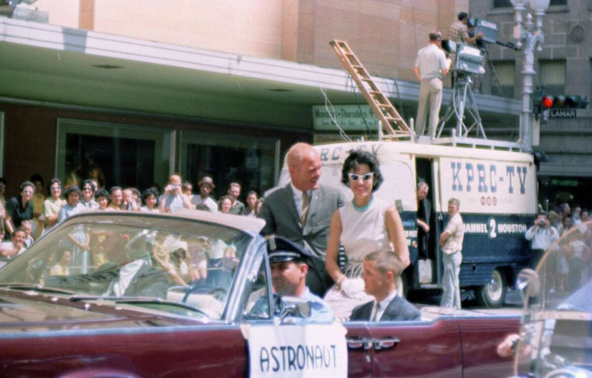 07/04/1962 - Welcome Manned Spacecraft Center parade organized by the Houston Chamber of Commerce. The parade welcomed astronauts, their families and MSC workers and their families - many of whom are newcomers to Houston. Astronaut John Glenn and his family greet the crowds. staff / Houston Chronicle