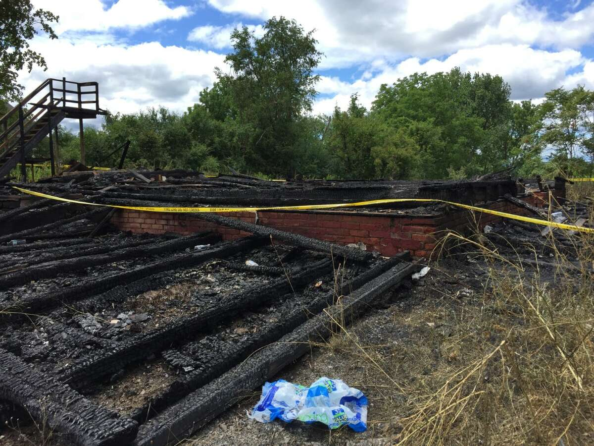 What remains of a two-story vacant house that burned to the ground in the early morning hours Sunday, July 10, 2016 on Columbia Turnpike in East Greenbush. (Matthew Hamilton)