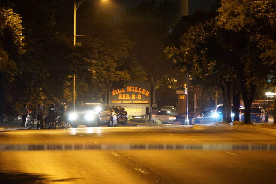 San Antonio police investigate shots fired near their headquarters Saturday night, July 9, 2016. Photo: Jacob Beltran
