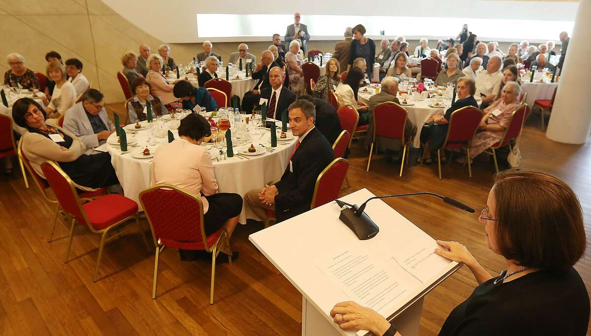 Stanlee Stahl, executive vice president of the Jewish Foundation for the Righteous, speaks during a luncheon in Warsaw, Poland, Sunday July 10, 2016. A group of Polish Christians who risked their lives to give aid to Jews during the Holocaust were brought together for a luncheon in Warsaw to be honored and celebrated by a U.S.-based Jewish organization that provides aid to these rescuers. (AP Photo/Czarek Sokolowski)