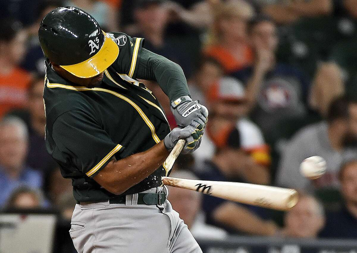 Oakland Athletics' Marcus Semien hits an RBI-double in the sixth inning of a baseball game against the Houston Astros, Sunday, July 10, 2016, in Houston. (AP Photo/Eric Christian Smith)
