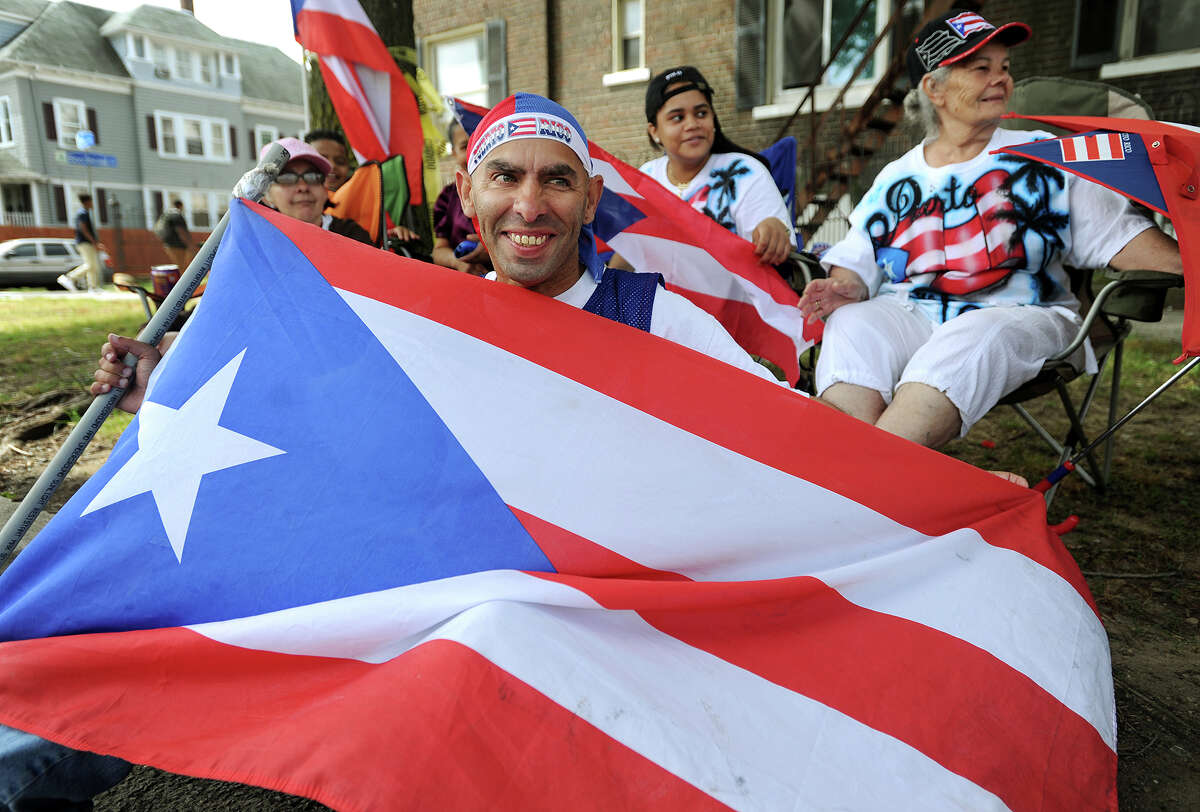 Jose Aviles, of Bridgeport, holds his Puerto Rican flag at the annual Puerto Rican Day Parade on Park Avenue in Bridgeport, Conn. on Sunday, July 10, 2016.