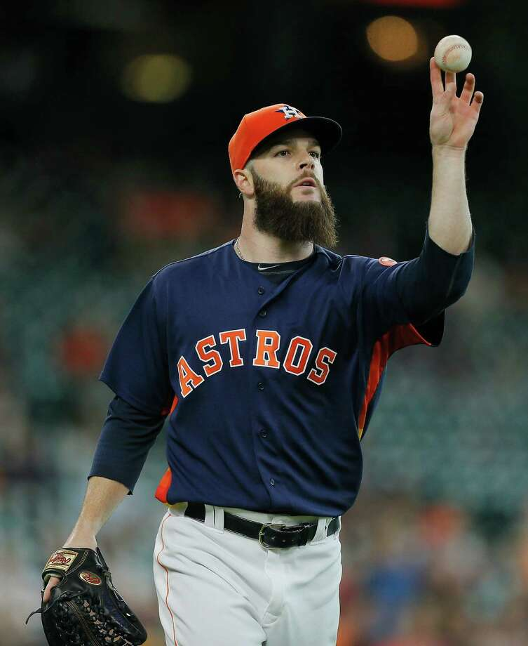 HOUSTON, TX - JULY 10:  Dallas Keuchel #60 of the Houston Astros tosses to first base to retire Coco Crisp #4 of the Oakland Athletics in the first inning at Minute Maid Park on July 10, 2016 in Houston, Texas. Photo: Bob Levey, Getty Images / 2016 Getty Images